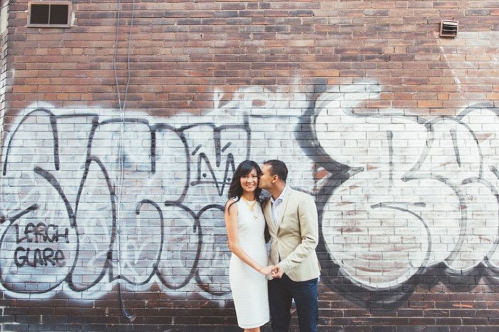 bride and groom portrait in front of graffiti