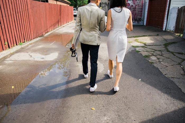 bride and groom walking down laneway