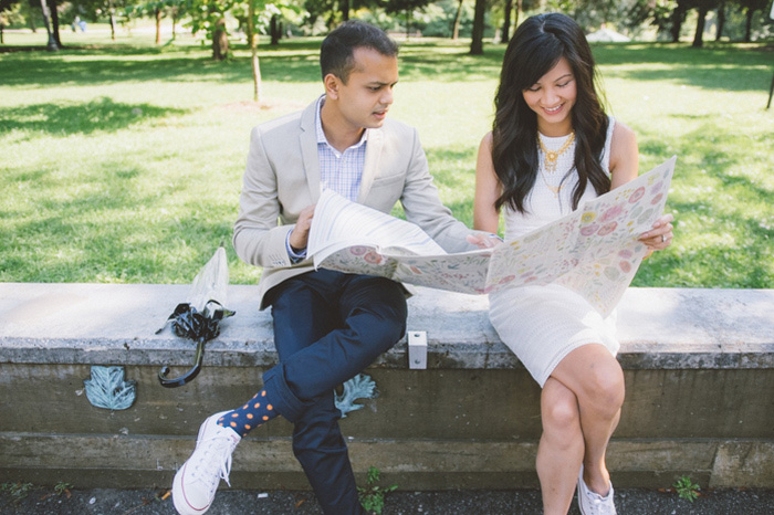 bride and groom reading map