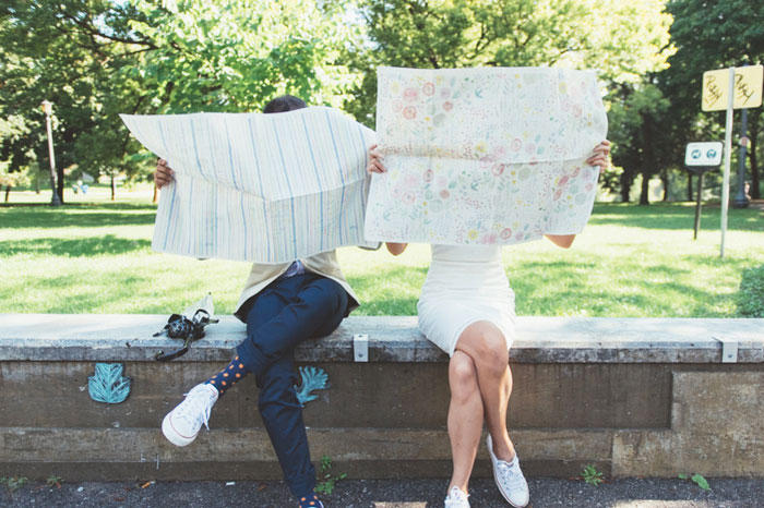 bride and groom reading maps