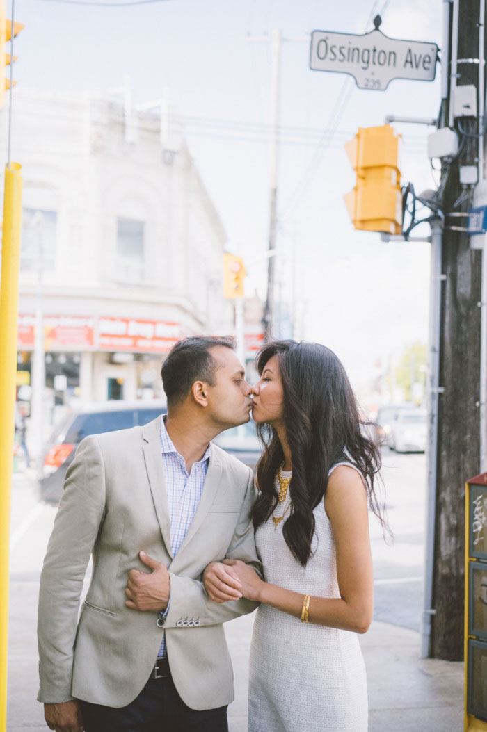 bride and groom kissing on the street