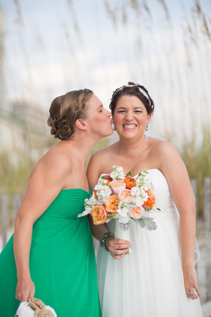 Maid of Honor kissing bride on cheek