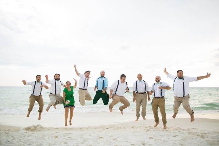 groomsmen portrait jumping on the beach
