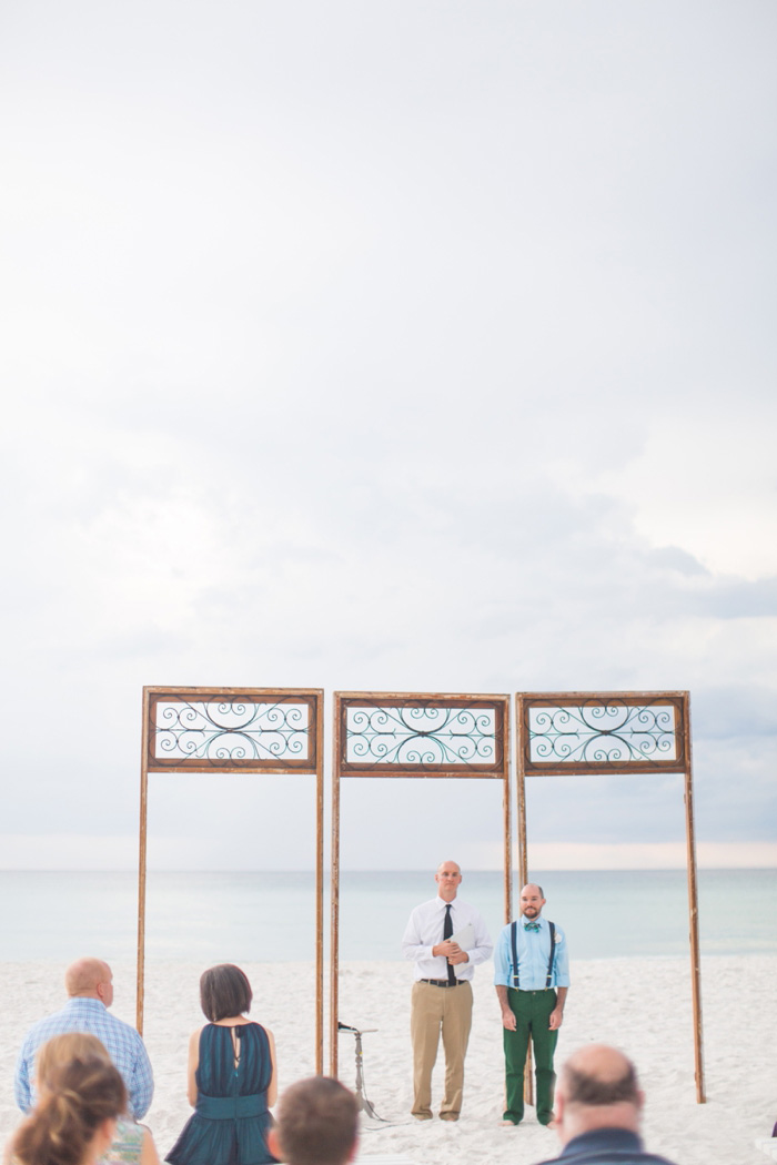 groom waiting at the altar on the beach