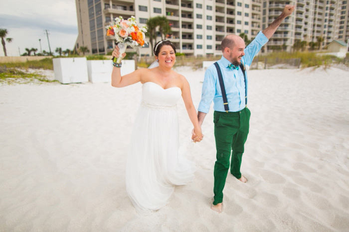 bride and groom celebrating on the beach