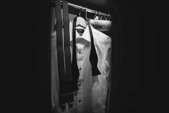 groom's tuxedo hanging in closet