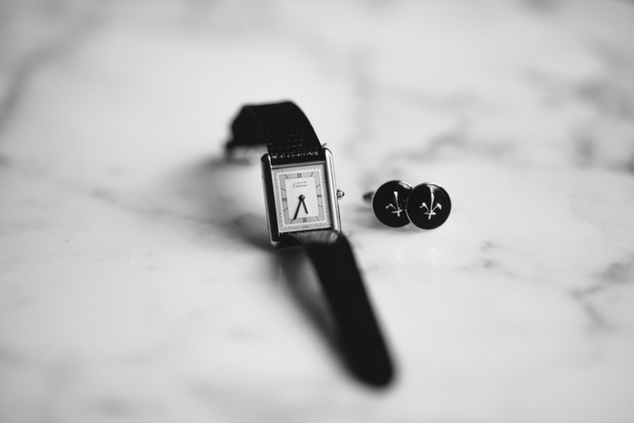 groom's watch and cufflinks laid out