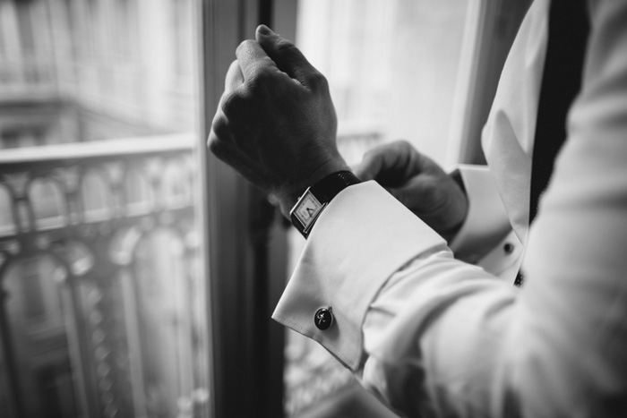 groom putting on his watch