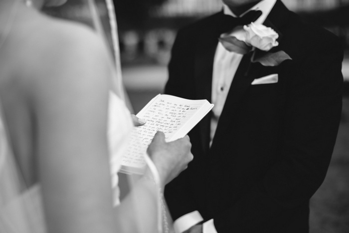 bride holding written vows during ceremony