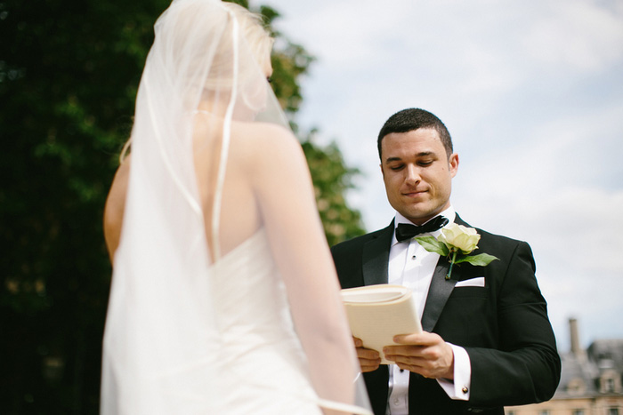 groom reading vows during elopement ceremony