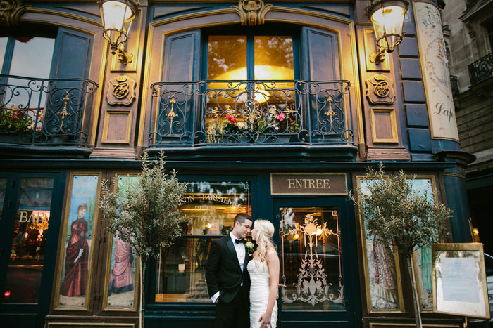 bride and groom in front of Paris Restaurant