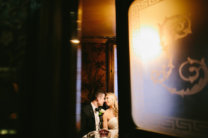 Bride and groom inside Paris restaurant