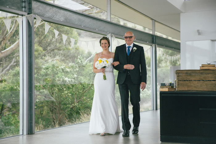 bride walking down aisle with her father