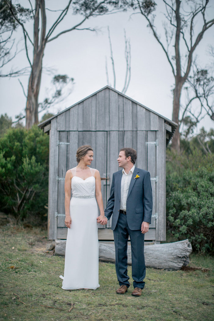 wedding portrait in front of shed