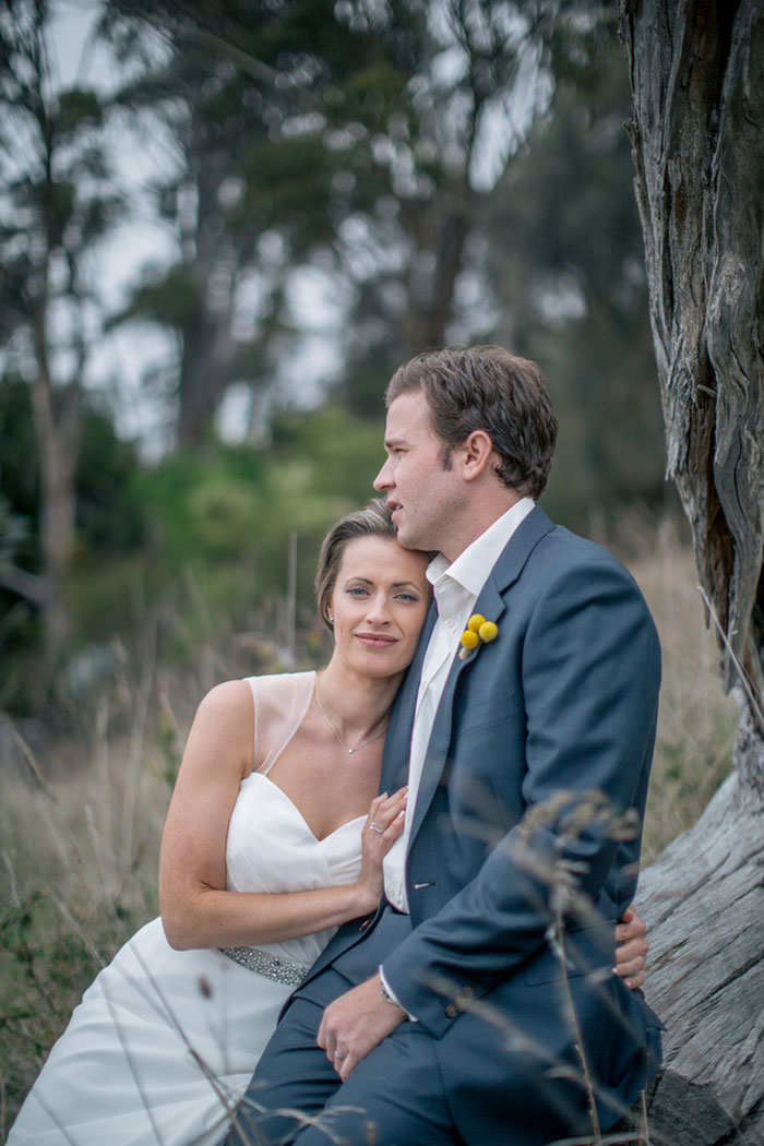 bride leaning on groom