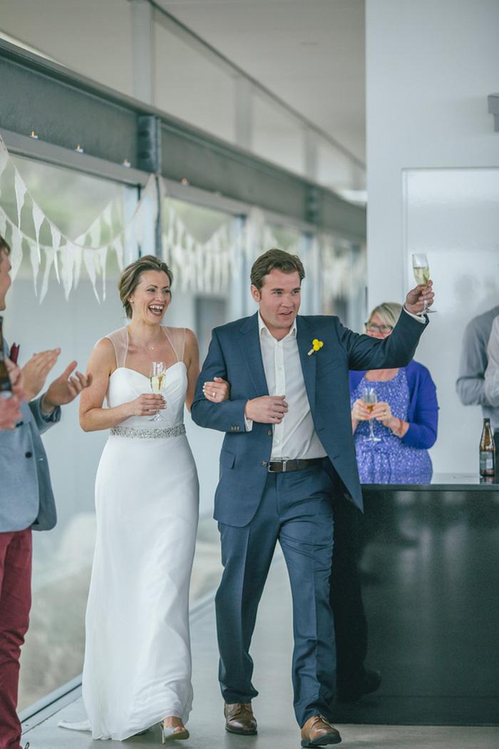 bride and groom making reception entrance