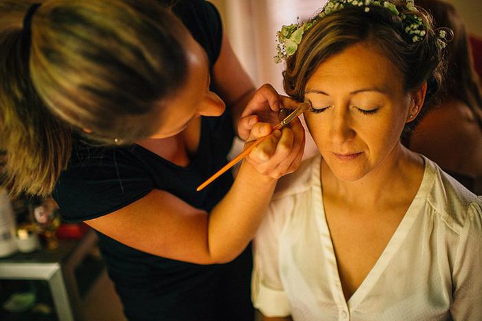 bride having her make-up done