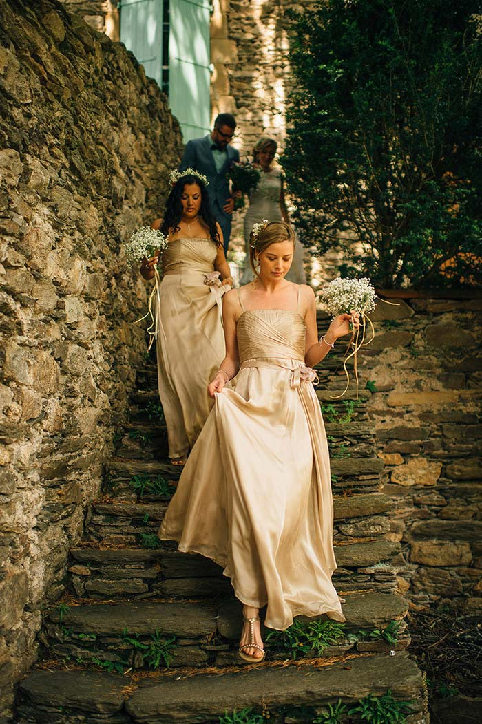 bridesmaids walking down stone steps
