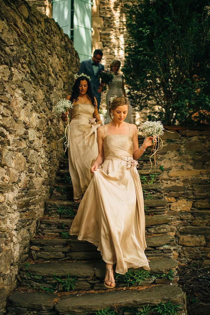 bridesmaids walking down stone steps