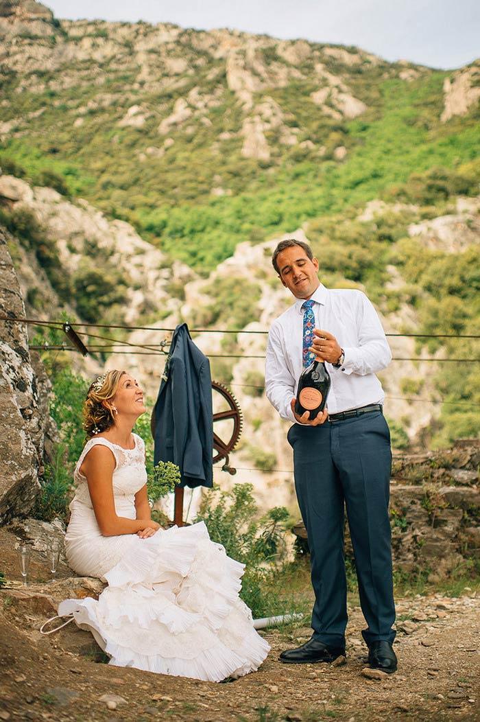 groom popping bottle of champagne