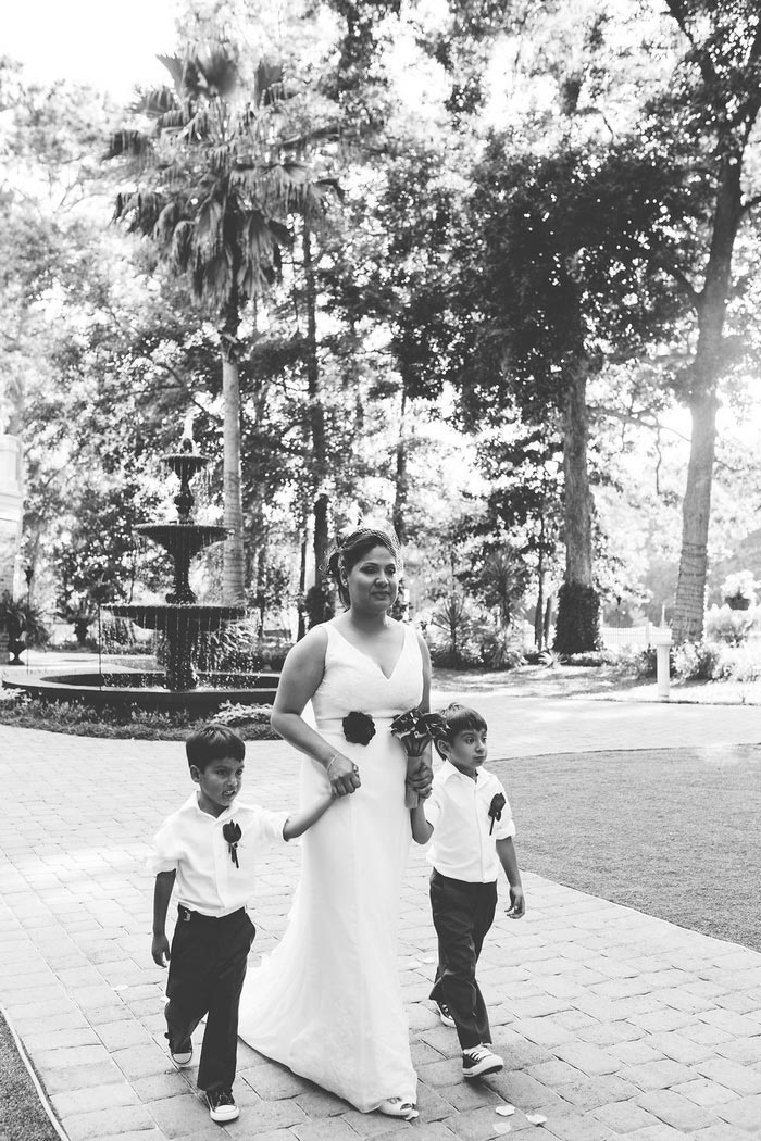 bride walking down aisle with sons