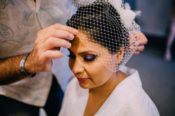 bride having her veil put on