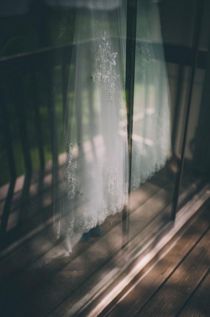 dress hanging against sliding glass door