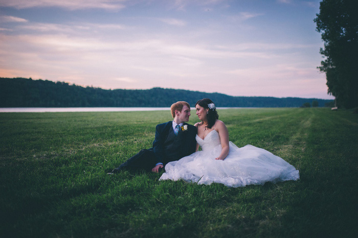 bride and groom portrait in the grass