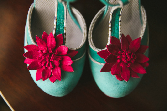 bride's teal shoes with fuchsia flowers