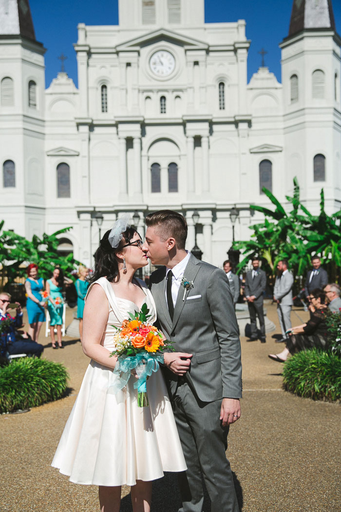 bride and groom kissing in Jackson Square