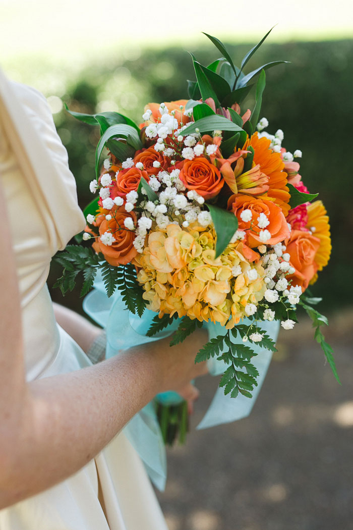 bride's orange and yellow bouquet