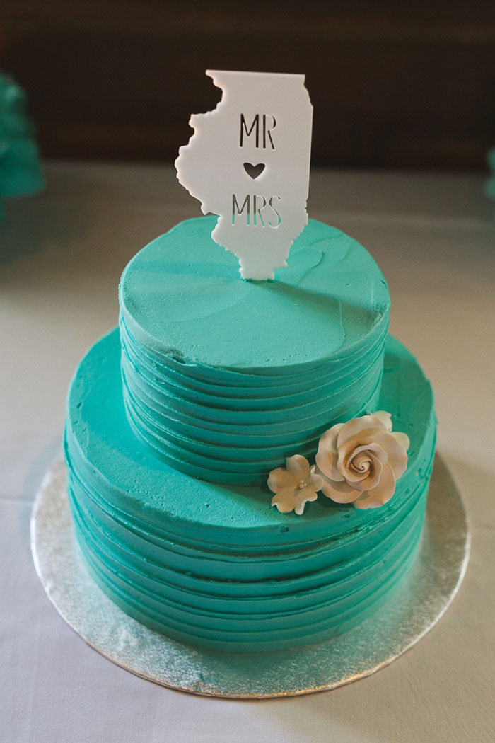 wedding cake with state cake topper