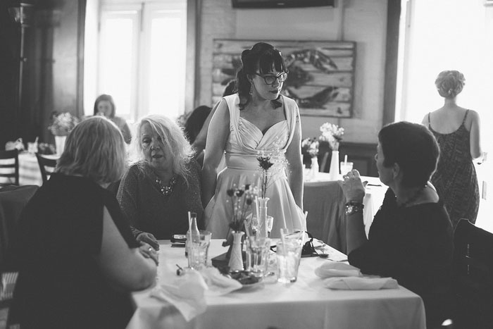 bride talking to guests at reception
