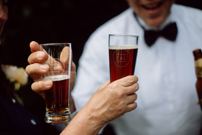 wedding guests with brown ale