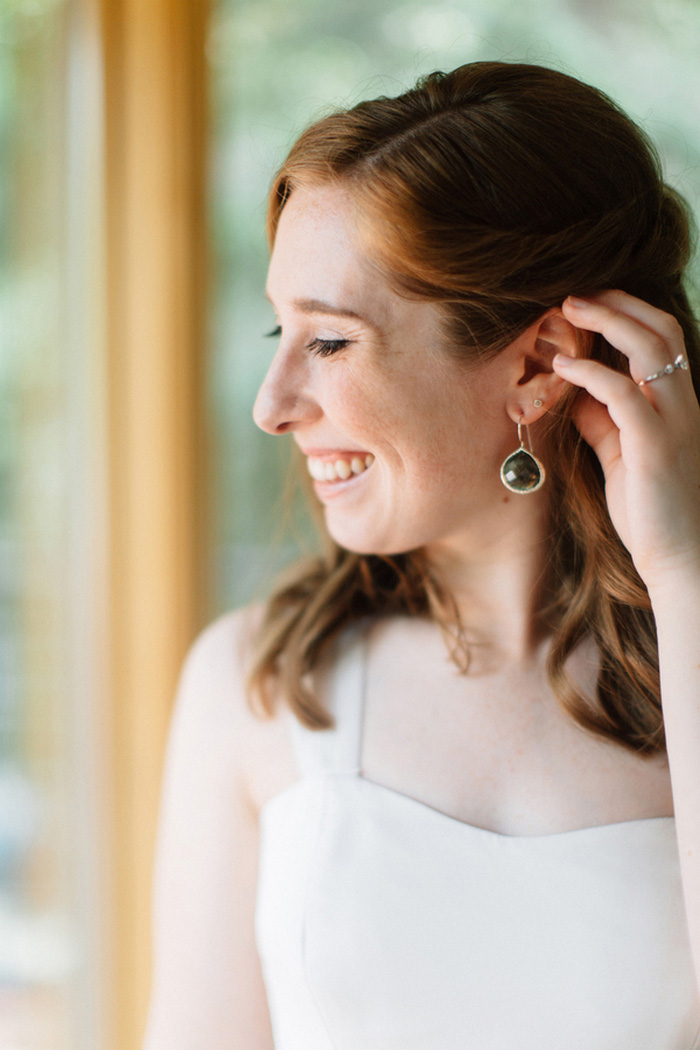 bride showing off earring