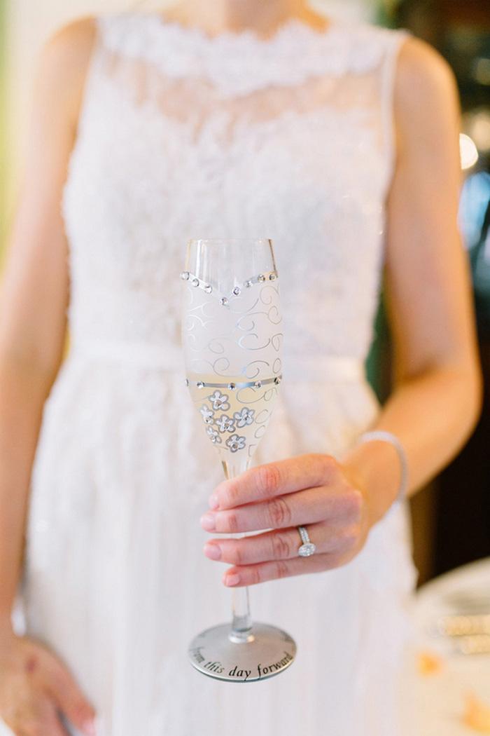 bride holding custom champagne flute