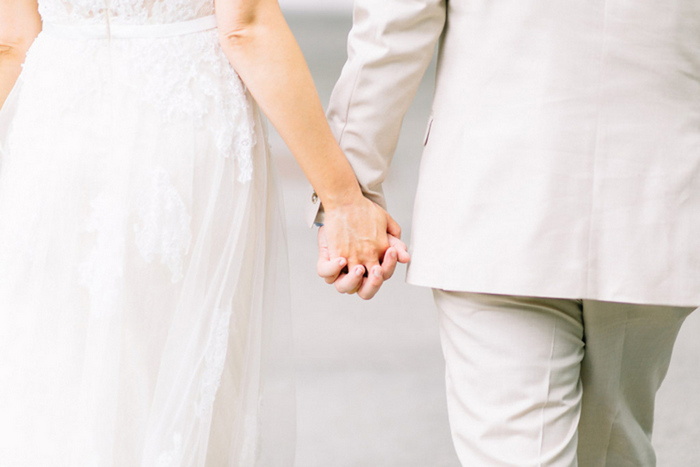brid and groom holding hands