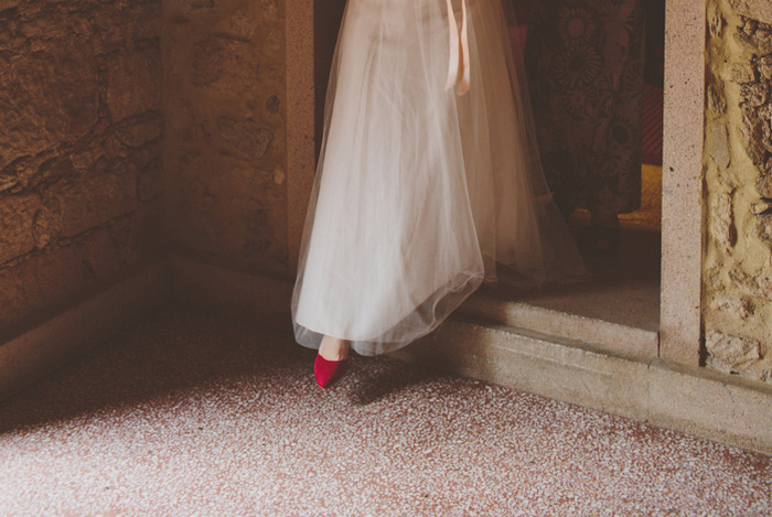 bride stepping through doorway