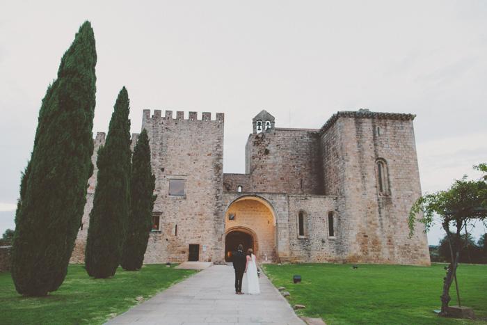 bride and groom entering castle