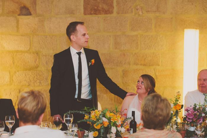 groom speaking at wedding reception