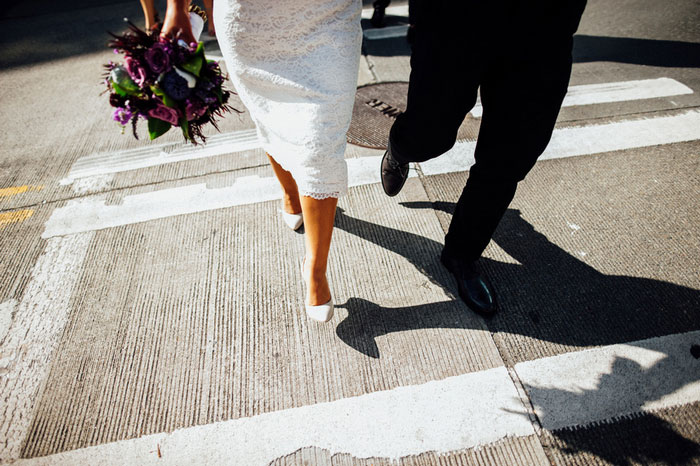 bride and groom crossing the street in Seattle