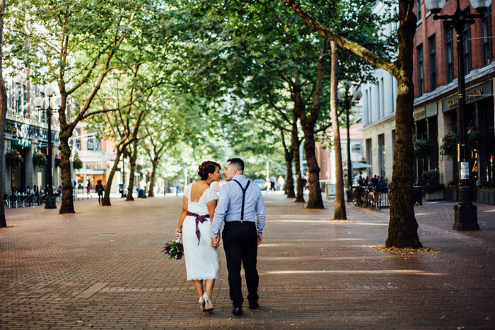 bride and groom walking down seattle street