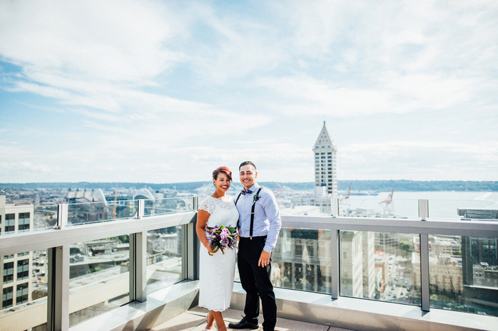 Bride and groom portrait on Seattle Courthouse roof