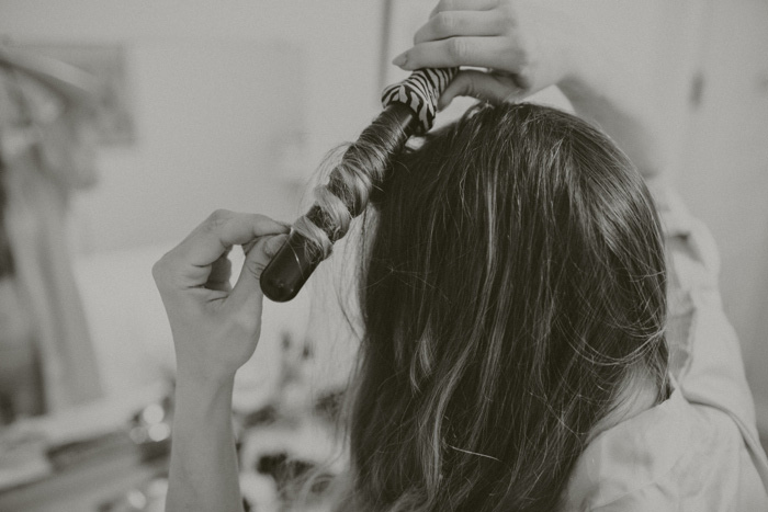 bride curling her hair