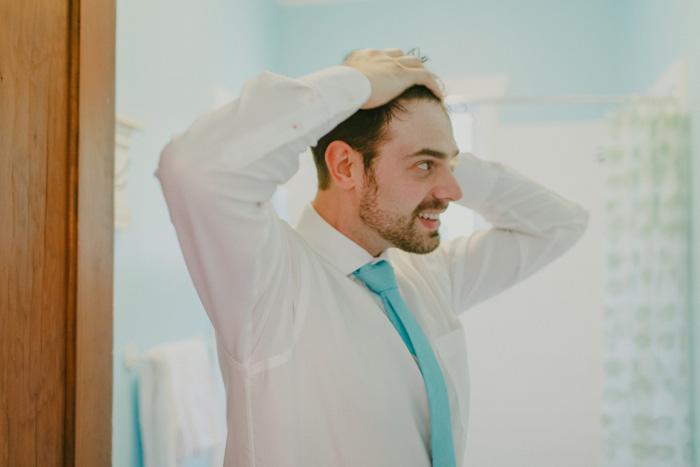 groom doing his hair