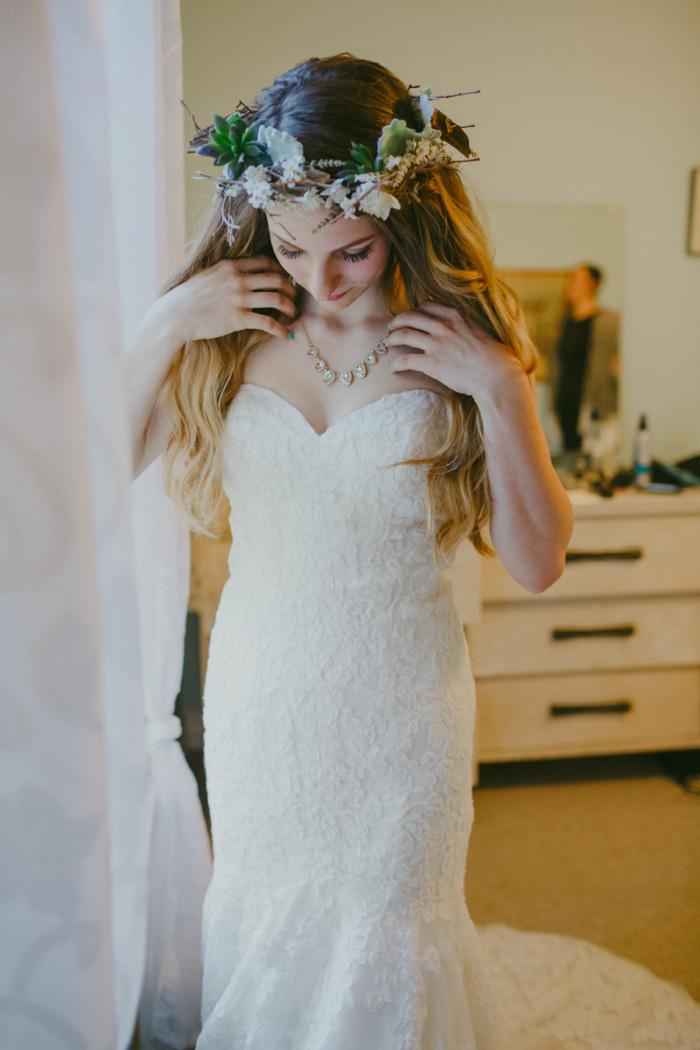 bride adjusting necklace