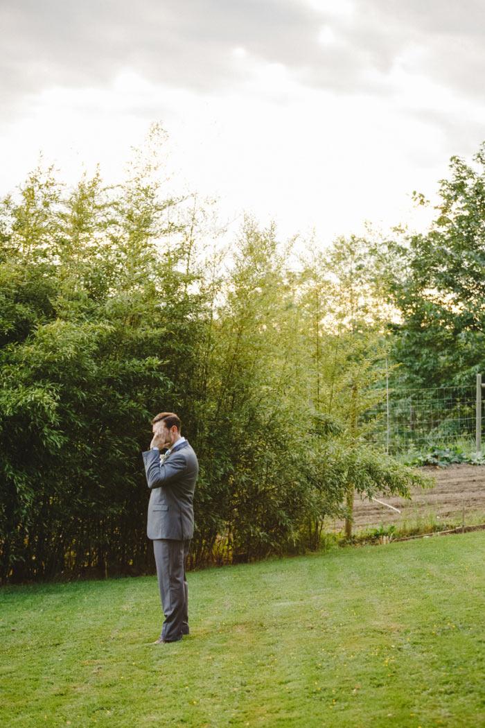 groom waiting to see his bride