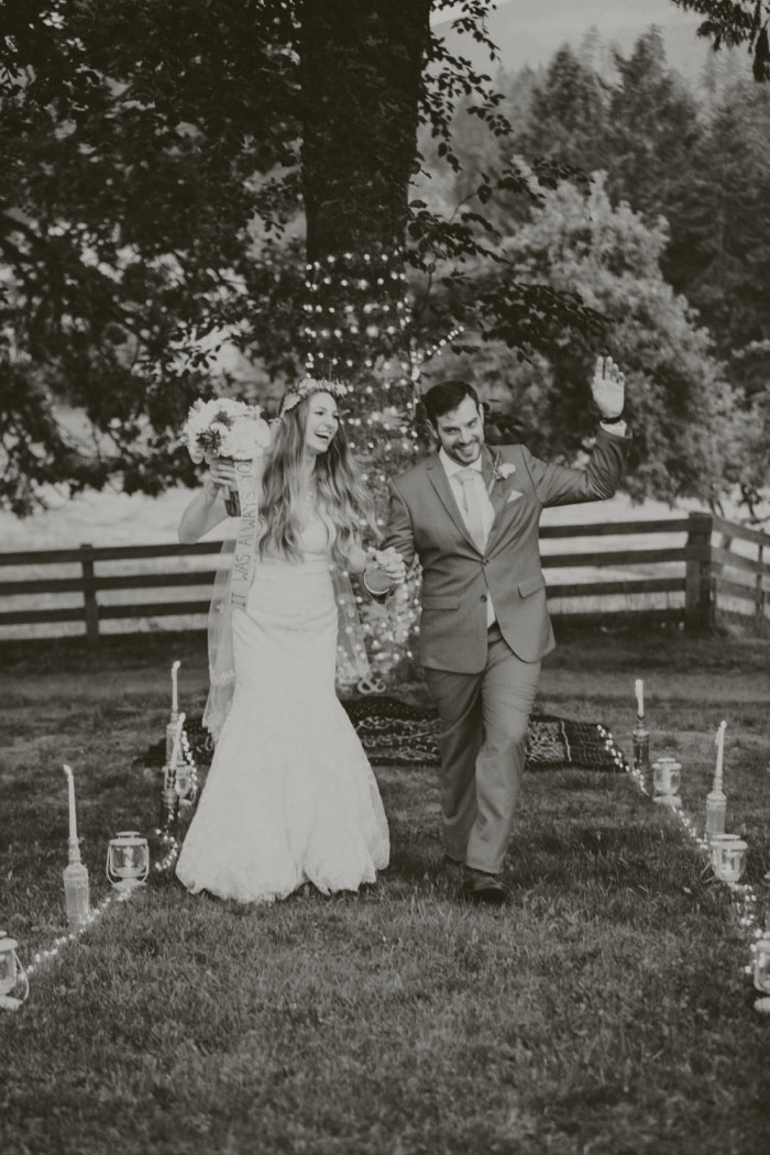 bride and groom walking up aisle as husband and wife