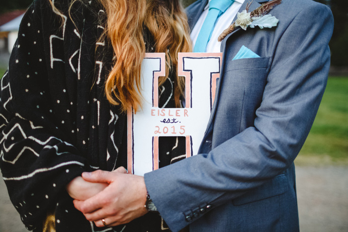 bride and groom holding letter h