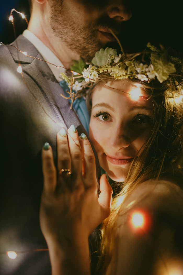 bride and groom wrapped in lights